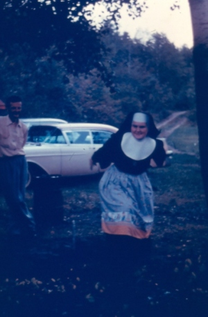 Sr Johnetta & Bill VanRossem playing horseshoes 1964 (location unknown)--submitted by Nancy Venne.